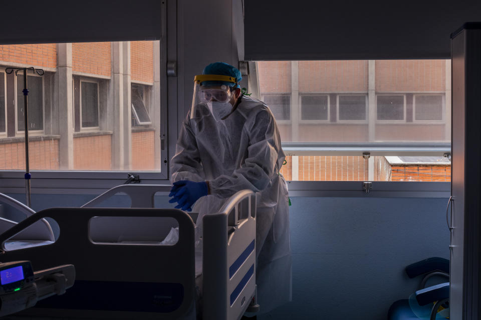 Santiago gazes, lost in his thoughts, during a visit to his father Santiago Collado at the COVID-19 ward in the Severo Ochoa Hospital in Leganes on the outskirts of Madrid, Spain, Wednesday, Feb. 17, 2021. The heart of his father Santiago Collado gave up on a recent day, shortly after his son and daughter were allowed to pay a last visit. (AP Photo/Bernat Armangue)