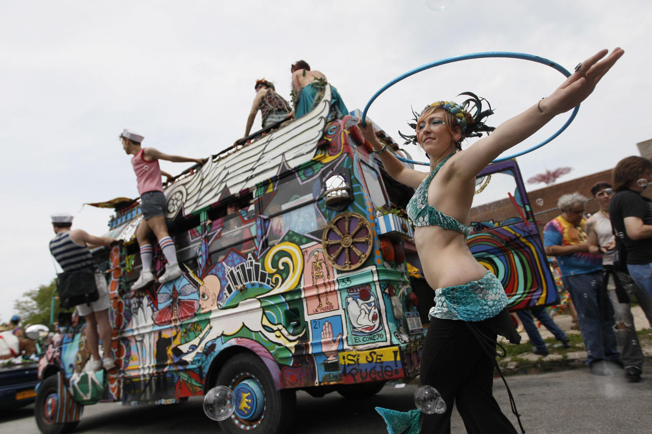 Madeleine Bell, of Philadalphia, Pa., is a mermaid hoop-dancer during the 2011 Mermaid Parade, Saturday, June 18, 2011 in New York's Coney Island. (AP Photo/Mary Altaffer)
