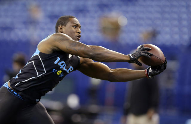 Florida State linebacker Christian Jones makes a catch as he runs a drill at the NFL football scouting combine in Indianapolis, Monday, Feb. 24, 2014. (AP Photo/Michael Conroy)