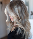 """""""It's right in between light brown and dark blond, like an ashier version of bronde,"""" says Brown of <a href=""""https://www.glamour.com/story/mushroom-blonde-hair?mbid=synd_yahoo_rss"""" rel=""""nofollow noopener"""" target=""""_blank"""" data-ylk=""""slk:this season's coolest blond shade"""" class=""""link rapid-noclick-resp"""">this season's coolest blond shade</a>. Because it doesn't really fall into either blond or brunette, it's a great shade for blonds looking to dip their toes into the dark side, or for brunettes wanting to go a little lighter. To get the color, Brown recommends asking your colorist for a light brown or dark blond subtle ombré, with a variation of both light brown and dark blond pieces. It's important to ask for something ashy, or else you'll be left with a more traditional bronde."""