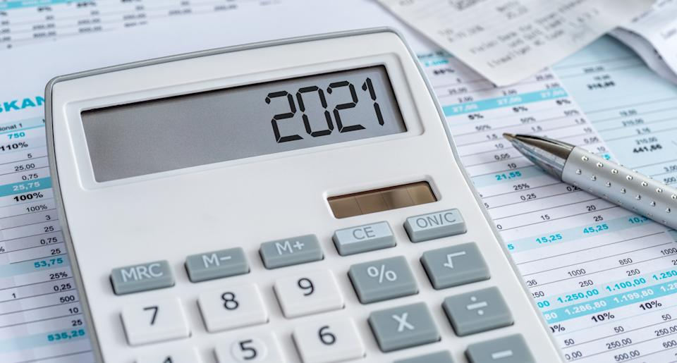 A calculator with the 2021 on the display
