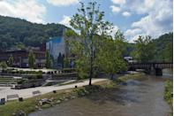 "<p><a href=""https://www.tripadvisor.com/Tourism-g59630-Welch_West_Virginia-Vacations.html"" rel=""nofollow noopener"" target=""_blank"" data-ylk=""slk:This town"" class=""link rapid-noclick-resp"">This town</a> used to be all about coal mining, but today it's rich in history. We recommend grabbing a bite and sitting next to the Elkhorn Creek that flows through the town and into the Tug Fort.</p>"