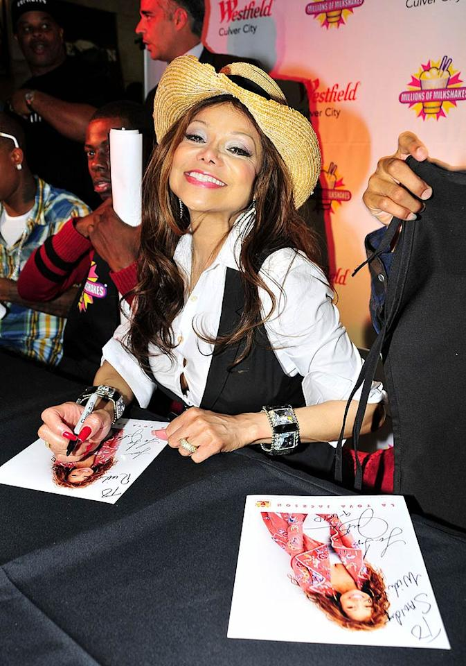 """After completing her behind-the-counter duties, La Toya made time to sign autographs and pose for pictures with fans. Koi Sojer/<a href=""""http://www.pacificcoastnews.com/"""" target=""""new"""">PacificCoastNews.com</a> - September 7, 2010"""