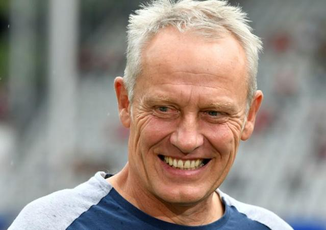 Freiburg coach Christian Streich was left smiling on Sunday after his team picked up a third win of the season (AFP Photo/THOMAS KIENZLE)