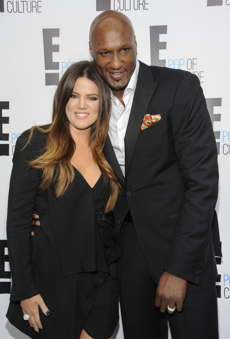 "FILE - This April 30, 2012 file photo shows TV personality Khloe Kardashian Odom and professional basketball player Lamar Odom from the show ""Keeping Up With The Kardashians"" at an E! Network upfront event in New York. After months of speculation, Kardashian is ending her four-year marriage to Odom. The Reality TV star filed for divorce Friday, Dec. 13, 2013, in Los Angeles County Superior Court, citing irreconcilable differences. (AP Photo/Evan Agostini, File)"