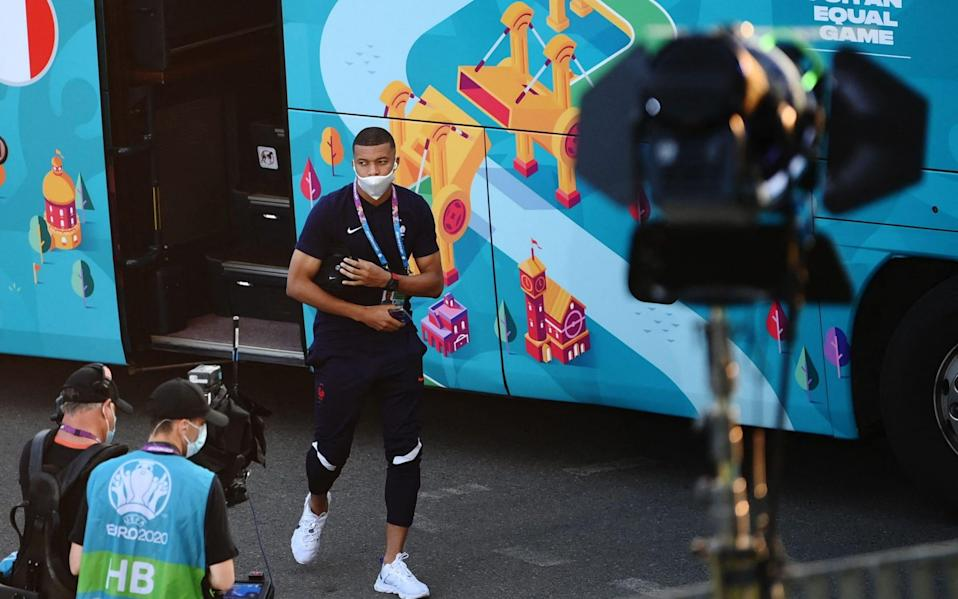 France's forward Kylian Mbappe exits the team bus as he arrives at the National Arena in Bucharest - AFP/Getty
