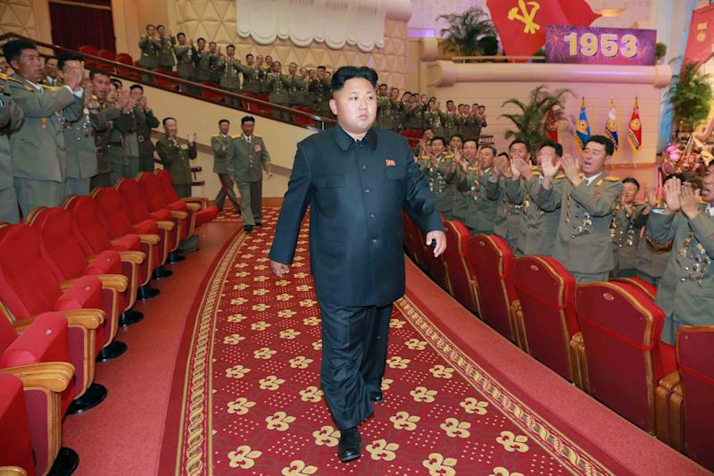 This undated file picture released by North Korea's official Korean Central News Agency on July 28, 2014 shows North Korean leader Kim Jong-Un (C) with Korean People's Army service personnel in Pyongyang (AFP Photo/)