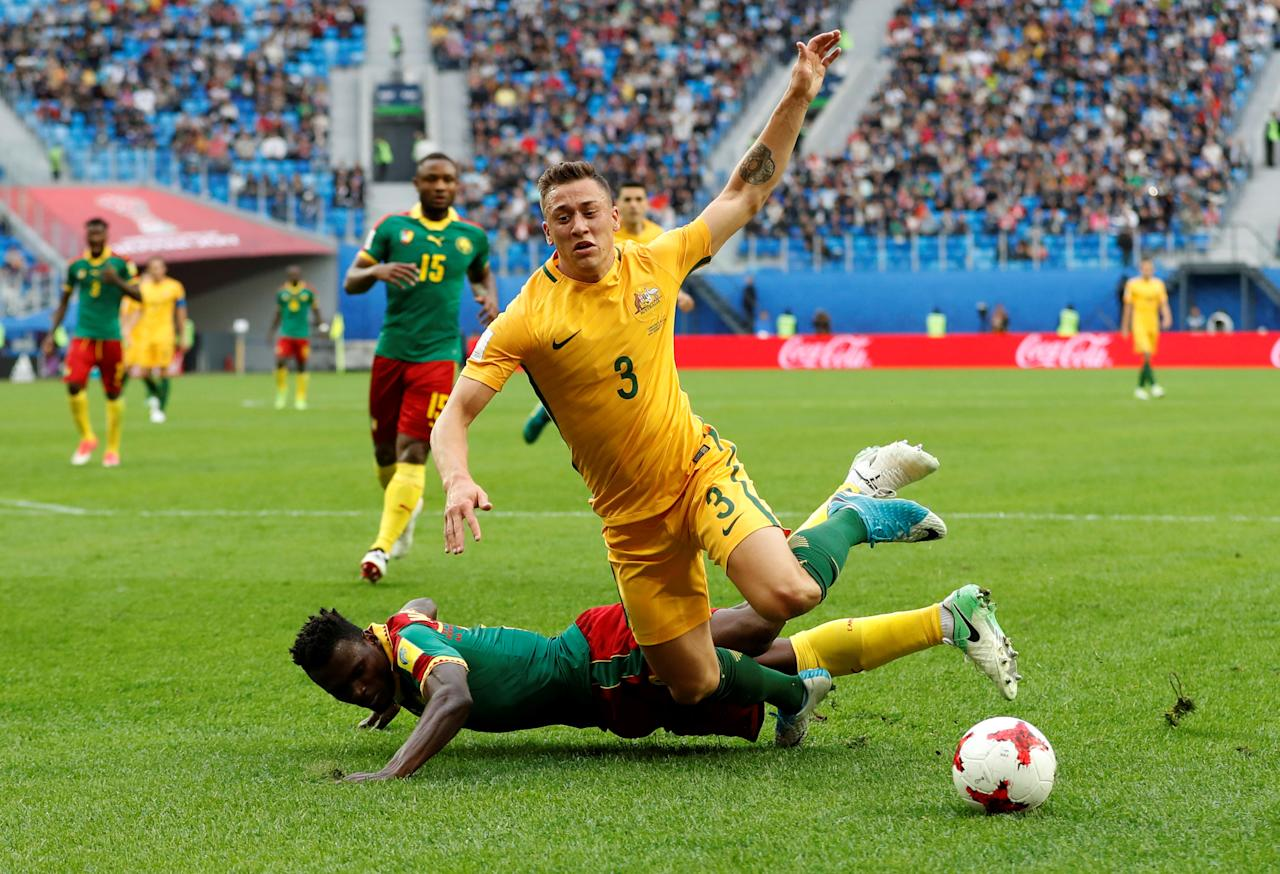 Soccer Football - Cameroon v Australia - FIFA Confederations Cup Russia 2017 - Group B - Saint Petersburg Stadium, St. Petersburg, Russia - June 22, 2017   Australia's Alex Gersbach is fouled by Cameroon's Ernest Mabouka resulting in a penalty to Australia   REUTERS/Carl Recine