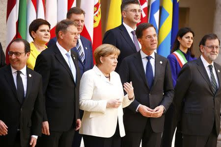 French President Hollande, Romania's President Iohannis, German Chancellor Merkel, Dutch PM Rutte and Spanish PM Rajoy pose for a family photo during a meeting on the 60th anniversary of theTreaty of Rome