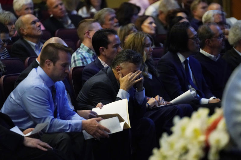 Frank DeAngelis, center, who was principal at Columbine High School during the massacre almost 20 years earlier, fights back tears during a faith-based memorial service for the victims at a community church, Thursday, April 18, 2019, in Littleton, Colo. (Rick Wilking/Pool Photo via AP)