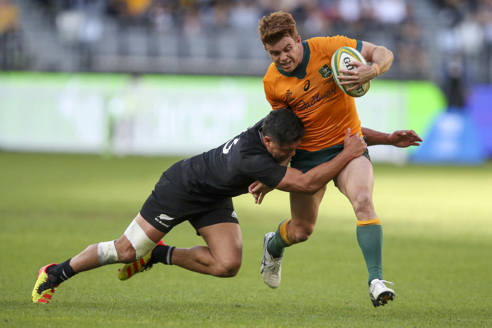 Australia's Andrew Kellaway is tackled by New Zealand's Anton Lienert-Brown during the Rugby Championship game between the All Blacks and the Wallabies in Perth, Australia, Sunday, Sept. 5, 2021. (AP Photo/Gary Day)