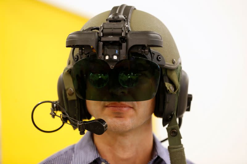 FILE PHOTO: An employee wears IronVision, a 360-degree helmet display system for tank troops, during a preview presentation at Elbit Systems