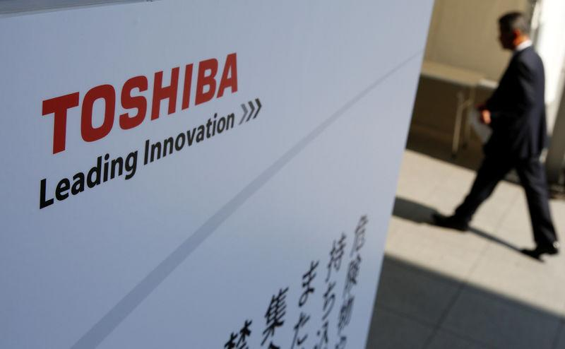 The logo of Toshiba is seen as a shareholder arrives at Toshiba's extraordinary shareholders meeting in Chiba