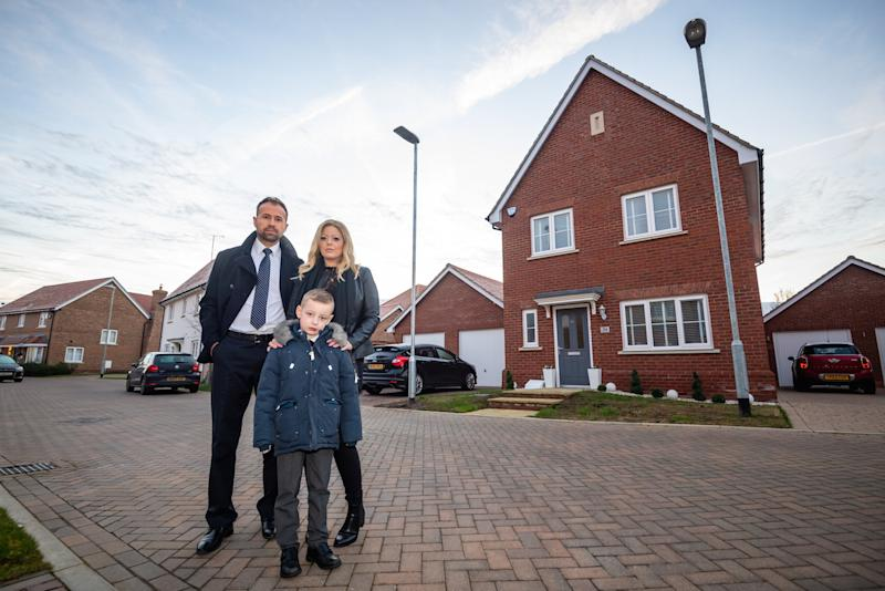 Steve Price 41, with his wife Louise Price ,40 and son Charlie Price age 6 outside their home in Maldon, Essex. A family is at war with housing developers over two lamp posts installed in the middle of the front garden of their £400k home. See SWNS story SWTPlampost. Steve Price, 41, has been at loggerheads with developers Crest Nicholson for three years in a complex legal battle. It started when the builders installed a new lamp post on the wrong side of his front door - and demanded it be moved 5.6m to the left. While uncovering the mistake, Steve and his wife Louise, 40, discovered they had been short changed - their lawn was 90cm shorter than it should be. Crest Nicholson offered the family £15,000 compensation for the lost land, and to buy a strip of land the council now needed for lamp post maintenance. But when Steve raised concerns about how much of his lawn would be lost to paving around the post, he claims Crest Nicholson withdrew the cash offer. Instead the housing company said it had struck a deal with the council over the access strip.