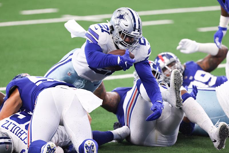 ARLINGTON, TEXAS - OCTOBER 11: Ezekiel Elliott #21 of the Dallas Cowboys dives for a touchdown against the New York Giants during the second quarter at AT&T Stadium on October 11, 2020 in Arlington, Texas. (Photo by Tom Pennington/Getty Images)