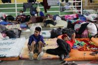 Residents rest at a shelter for people affected by the floods caused by heavy rain brought by Storm Iota in San Pedro Sula