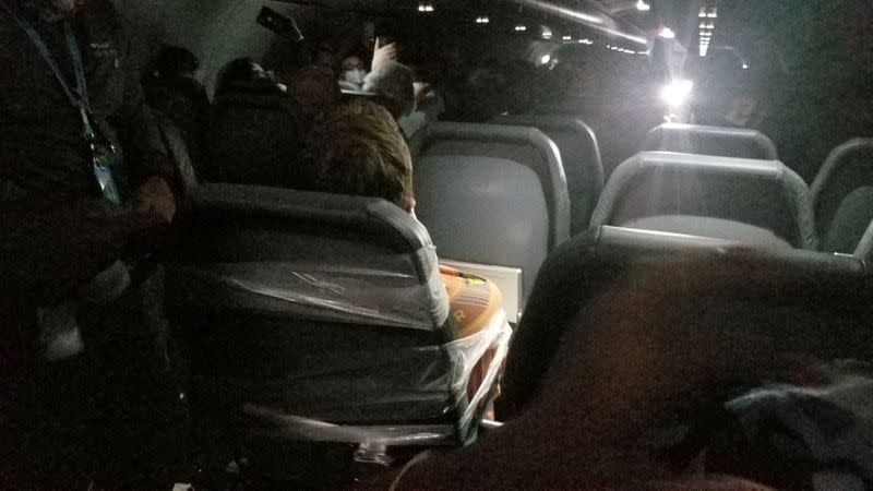 A man sits taped to a seat on a Frontier Airlines flight from Philadelphia to Miami