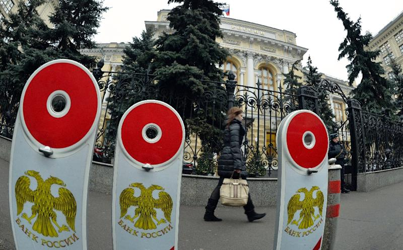 A woman walks past the head office of the Central Bank in Moscow