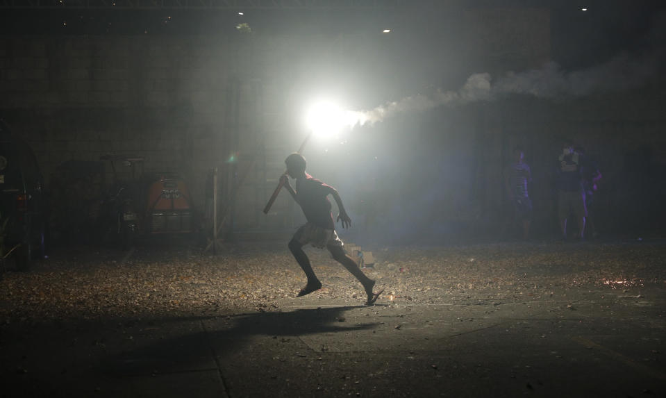 A Filipino boy runs with a bright firework as they celebrate the coming of the New Year early Wednesday, Jan. 1, 2020 in Manila, Philippines. Filipinos welcome the New Year with noise and firecrackers in the belief that this will drive away bad spirits and bring in good luck. (AP Photo/Aaron Favila)