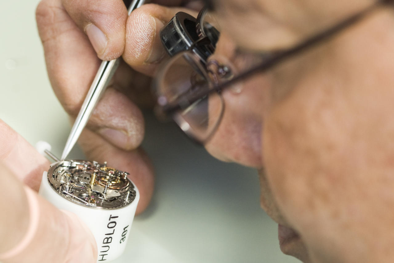 A man works on a Hublot watch at the Swiss watchmaker manufacture in Nyon November 5, 2009. REUTERS/Valentin Flauraud (SWITZERLAND BUSINESS)