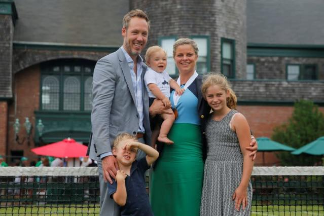 Kim Clijsters of Belgium and her family pose for a photograph after she was inducted into the International Tennis Hall of Fame in Newport