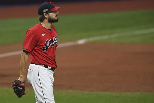 Cleveland Indians relief pitcher Brad Hand waits before being removed during the ninth inning of Game 2 of the team's American League wild-card baseball series against the New York Yankees, early Thursday, Oct. 1, 2020, in Cleveland. The Yankees won 10-9. (AP Photo/David Dermer)