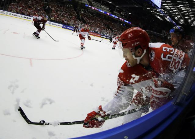 Ice Hockey - 2018 IIHF World Championships - Group B - Latvia v Denmark - Jyske Bank Boxen - Herning, Denmark - May 15, 2018 - Patrick Russell of Denmark in action with Guntis Galvins of Latvia. Picture taken with a fisheye lens. REUTERS/David W Cerny