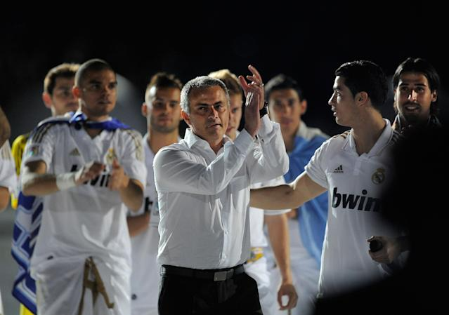 MADRID, SPAIN - MAY 13: Real Madrid CF head coach Jose Mourinho (C) celebrates the La Liga title with Cristiano Ronaldo (R) after the La Liga match between Real Madrid CF and RCD Mallorca at Estadio Santiago Bernabeu on May 13, 2012 in Madrid, Spain. (Photo by Denis Doyle/Getty Images)
