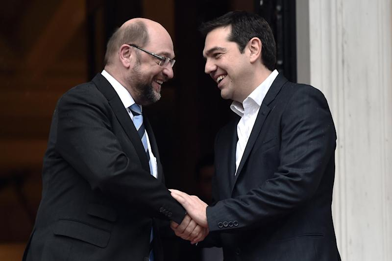 Greek Prime Minister Alexis Tsipras (R) shakes hands with European Parliament Chairman Martin Schulz as he welcomes him in Athens on January 29, 2015 (AFP Photo/Aris Messinis)