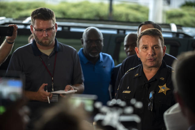 <p>Jacksonville Sheriff Mike Williams, right, holds a news conference, Aug. 26, 2018, in Jacksonville, Fla., after a gunman opened fire Sunday during an online video game tournament that was being live streamed from a Florida mall, killing multiple people and sending many others to hospitals. (Photo: Laura Heald/AP) </p>