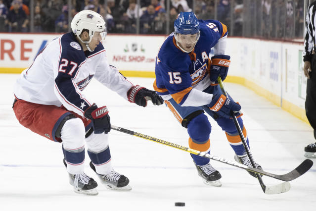 Columbus Blue Jackets defenseman Ryan Murray (27) skates against New York Islanders right wing Cal Clutterbuck (15) during the second period of an NHL hockey game, Saturday, Nov. 30, 2019, in New York. (AP Photo/Mary Altaffer)