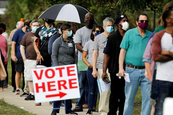 PHOTO: Voters wait in line to enter a polling place and cast their ballots on the first day of the state's in-person early voting for the general election in Durham, N.C., Oct. 15, 2020. (Jonathan Drake/Reuters, File)
