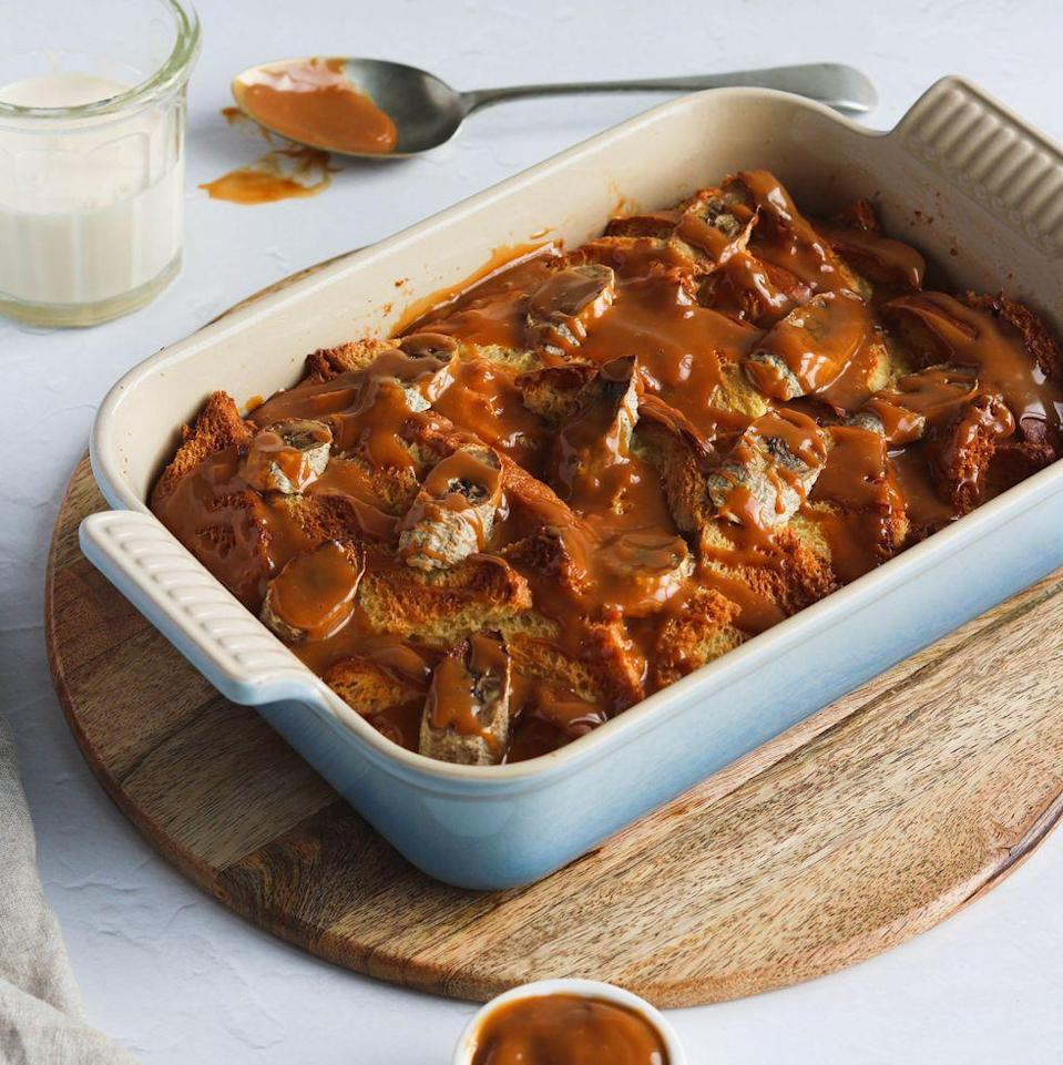 """<p><a href=""""https://www.delish.com/uk/food-news/a32015605/hot-cross-bun-bread-and-butter-pudding-aldi/"""" rel=""""nofollow noopener"""" target=""""_blank"""" data-ylk=""""slk:Bread and butter pudding"""" class=""""link rapid-noclick-resp"""">Bread and butter pudding</a> is a classic, and not only is this brioche bread and butter pudding, but we've also taken inspiration from the flavours of <a href=""""https://www.delish.com/uk/food-news/a29709703/lidl-banoffee-spread-salted-caramel-spread-gingerbread-spread/"""" rel=""""nofollow noopener"""" target=""""_blank"""" data-ylk=""""slk:banoffee"""" class=""""link rapid-noclick-resp"""">banoffee</a> pie. Soaked in <a href=""""https://www.delish.com/uk/cooking/recipes/a29320067/custard-banana-bread/"""" rel=""""nofollow noopener"""" target=""""_blank"""" data-ylk=""""slk:custard"""" class=""""link rapid-noclick-resp"""">custard</a>, then stuffed with banana slices, once cooked this bread and butter pud is drizzled with warm <a href=""""https://www.delish.com/uk/cooking/recipes/a34392029/caramel-rolo-fudge-recipe/"""" rel=""""nofollow noopener"""" target=""""_blank"""" data-ylk=""""slk:caramel"""" class=""""link rapid-noclick-resp"""">caramel</a> before serving. DELICIOUS! </p><p>Get the <a href=""""https://www.delish.com/uk/cooking/recipes/a35762716/brioche-bread-and-butter-pudding/"""" rel=""""nofollow noopener"""" target=""""_blank"""" data-ylk=""""slk:Banoffee Brioche Bread and Butter Pudding"""" class=""""link rapid-noclick-resp"""">Banoffee Brioche Bread and Butter Pudding</a> recipe.</p>"""