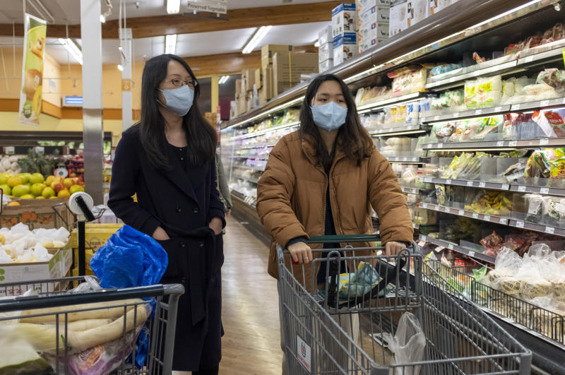 People wear surgical masks while shopping at a grocery store in Cupertino, California, United States on January 23, 2020 before the start of Lunar New Year. There are now 8,235 confirmed cases of coronavirus, with 171 death and 143 recovered. (Photo by Yichuan Cao/NurPhoto via Getty Images)