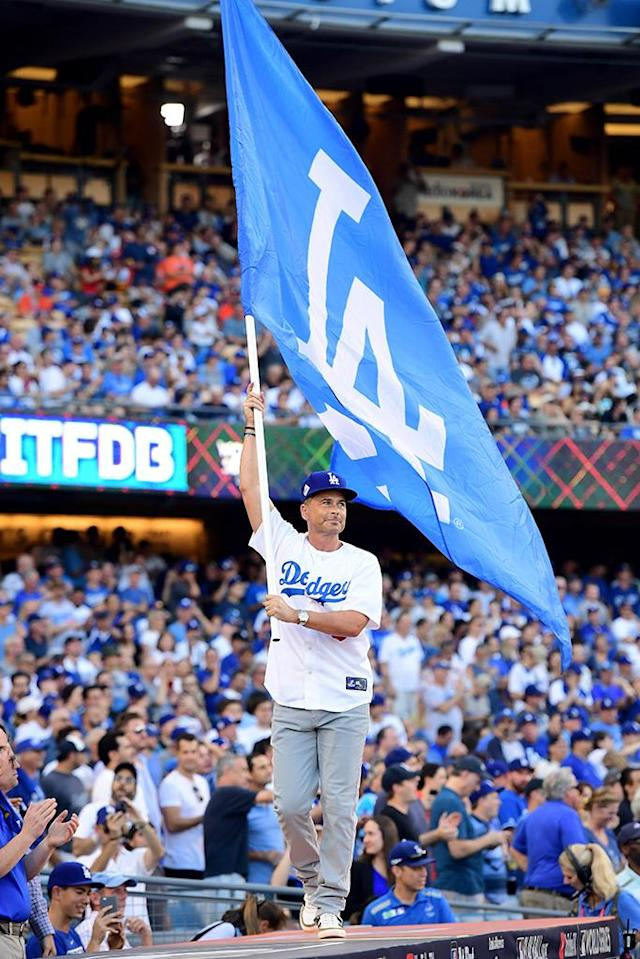 <p>The devoted fan waved a Los Angeles Dodgers flag before Game 1 of the 2017 World Series between the Houston Astros and the Dodgers at Dodger Stadium on Tuesday. And it looks like Lowe brought his team some good luck. The hometown squad came out on top 3-1, taking the lead in the best-of-seven series. (Photo: Harry How/Getty Images) </p>