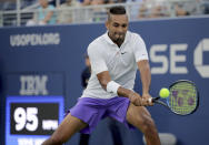 Nick Kyrgios, of Australia, returns a shot to Antoine Hoang, of France, during the second round of the US Open tennis championships Thursday, Aug. 29, 2019, in New York. (AP Photo/Charles Krupa)
