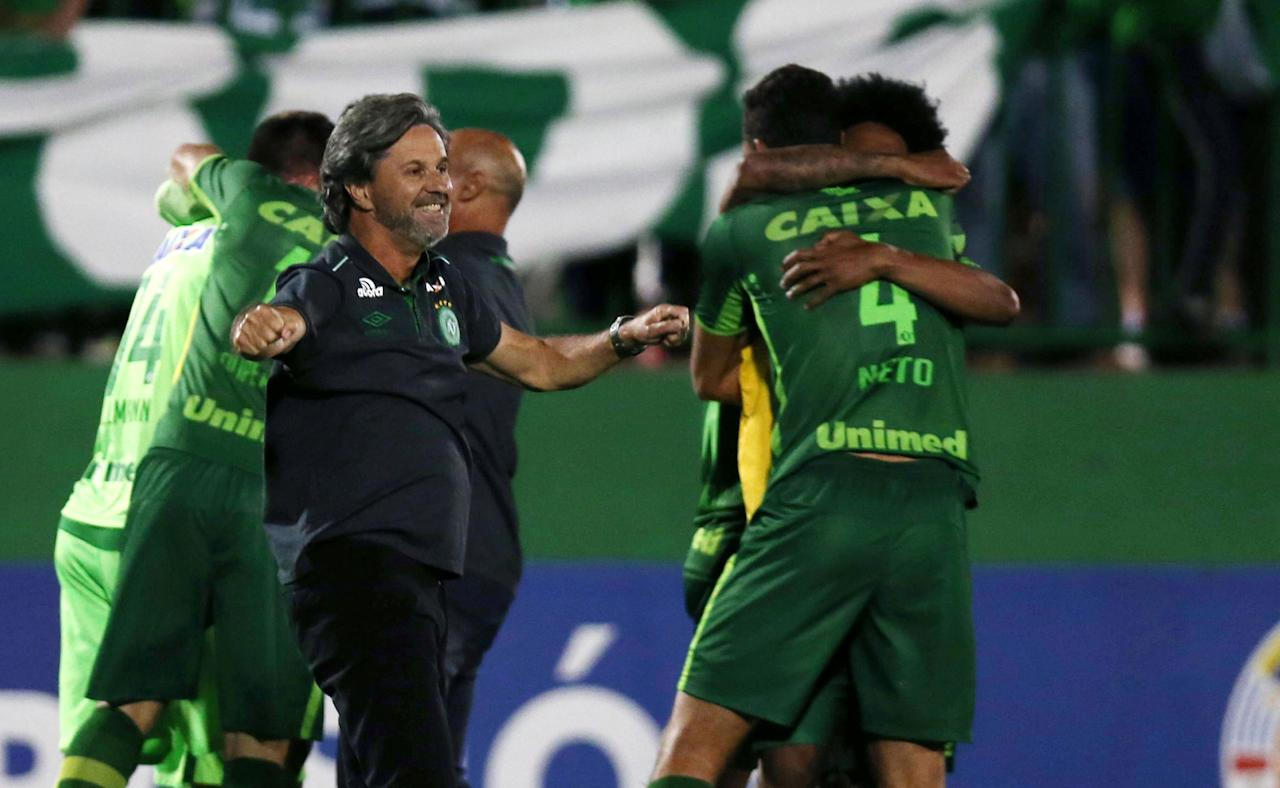 <p>Head coach Caio Junior of Chapecoense celebrates with his players after their match against San Lorenzo in the Copa Sudamericana at the Arena Conda stadium in Chapeco, Brazil on Nov. 23, 2016. (Paulo Whitaker/Reuters) </p>