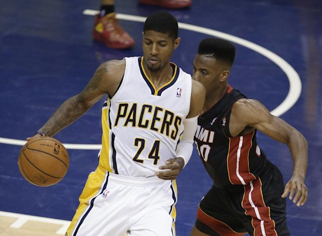 Indiana Pacers' Paul George (24) works against Miami Heat's Norris Cole during the first half of Game 5 of the Eastern Conference finals NBA basketball playoff series, Wednesday, May 28, 2014, in Indianapolis. (AP Photo/Darron Cummings)