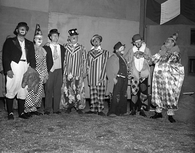 """<p>Seven of these eight costumed clowns are radio and television personalities, while the eighth (third from right) is Otto Griebling, who earns his livelihood as a clown with Ringling Brothers and Barnum and Bailey Circus. Group gathered at New York's Madison Square Garden, April 1, 1953 for opening performance of """"The Greatest Show On Earth."""" From left are: Al Schacht, perennial baseball clown; Garry Moore, Sid Caesar, Lauritz Melchior, Jack Carter, Otto Griebling, Herb Shriner and Sam Levenson. The radio and TV personalities participated in the opening night performance with proceeds going to United Cerebral Palsy of New York. (AP Photo/Matty Zimmerman) </p>"""
