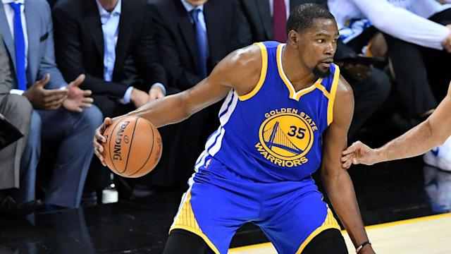 Kevin Durant said the team has to play with a different style when point guard Stephen Curry, who is injured, isn't on the court.