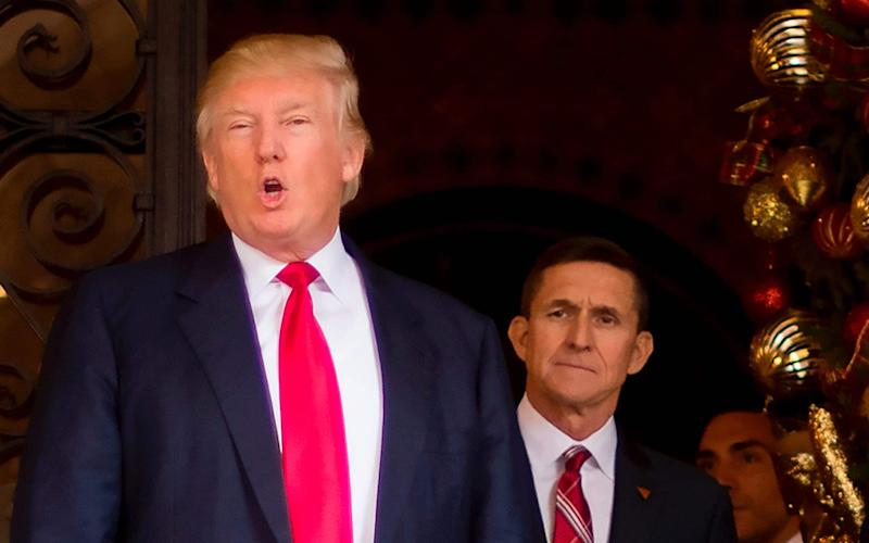 Donald Trump with Michael Flynn - Credit: JIM WATSON/AFP