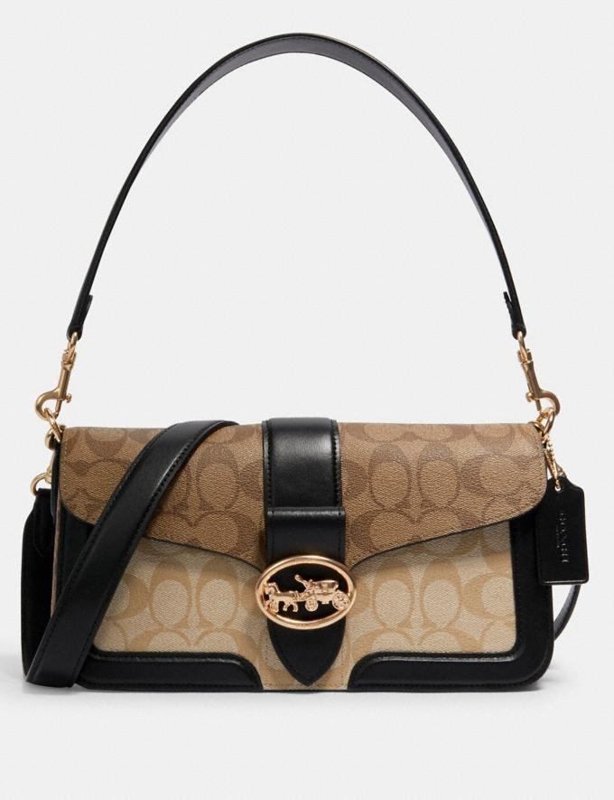 Georgie Shoulder Bag In Blocked Signature Canvas. Image via Coach Outlet.