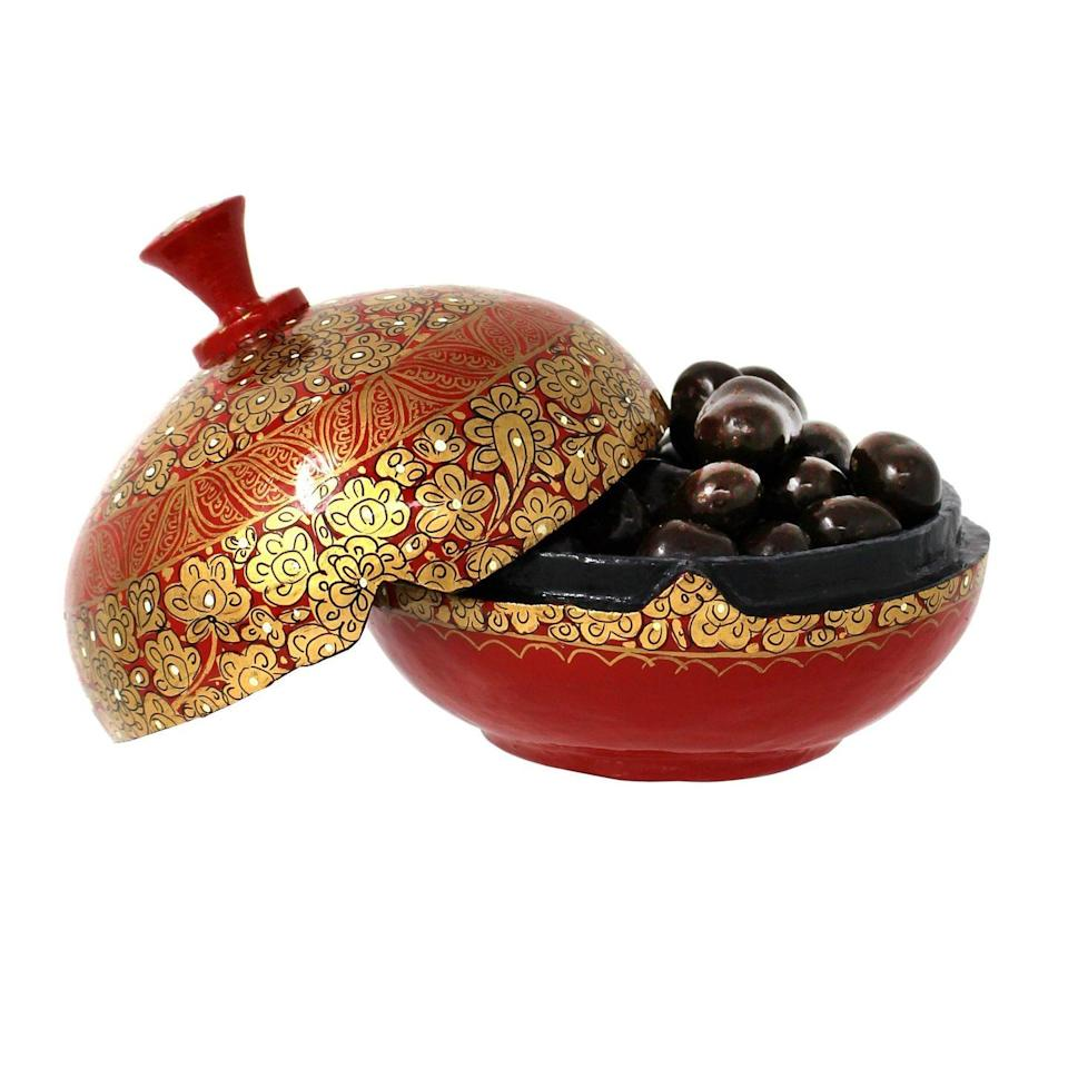 """<p><a class=""""link rapid-noclick-resp"""" href=""""https://www.farhi.co.uk/collections/best-sellers/products/dark-chocolate-coated-coffee-beans-in-a-hand-made-papier-mache-bonbonniere"""" rel=""""nofollow noopener"""" target=""""_blank"""" data-ylk=""""slk:SHOP NOW"""">SHOP NOW</a></p><p>Caffeine addicts will adore these aromatic chocolate-covered beans, exquisitely presented in a handmade papier-mâché bonbonnière.</p><p>Chocolate-coated coffee beans in a bonbonnière, from £15, Rita Farhi</p>"""