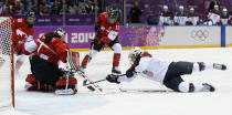 Jocelyne Lamoureux of the United States (17) tries to score against goalkeeper Shannon Szabados of Canada (1) during the second period of the women's gold medal ice hockey game at the 2014 Winter Olympics, Thursday, Feb. 20, 2014, in Sochi, Russia. (AP Photo/Matt Slocum)