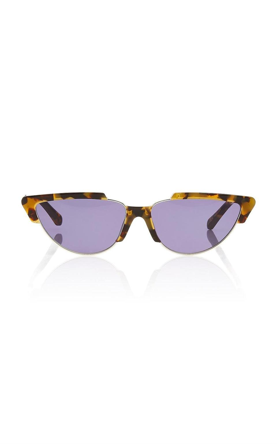 We love the cool contrast between the purple lense and the tortoise frame.