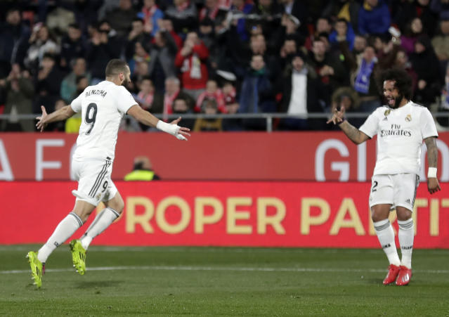 Real Madrid's Benzema, left, celebrates after scoring during a Spanish Copa del Rey soccer match between Girona and Real Madrid at the Montilivi stadium in Girona, Spain, Thursday, Jan. 31, 2019. (AP Photo/Manu Fernandez)