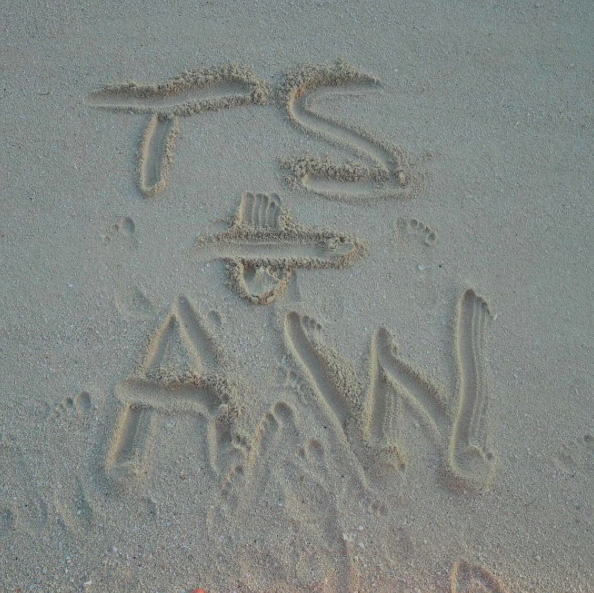 The whole trip was very Taylor Swift. In addition to the perfectly choreographed kiss pic, there were snaps like this of their initials in the sand. For the uninitiated, his real name is Adam Wiles. (Photo: Instagram)