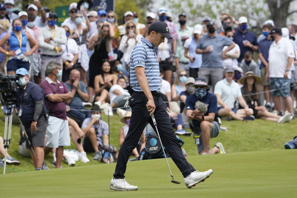 Jordan Spieth walks across the 18th green after missing a birdie putt during a round of 16 match against Matt Kuchar at the Dell Technologies Match Play Championship golf tournament Saturday, March 27, 2021, in Austin, Texas. Kuchar won the hole and the match. (AP Photo/David J. Phillip)