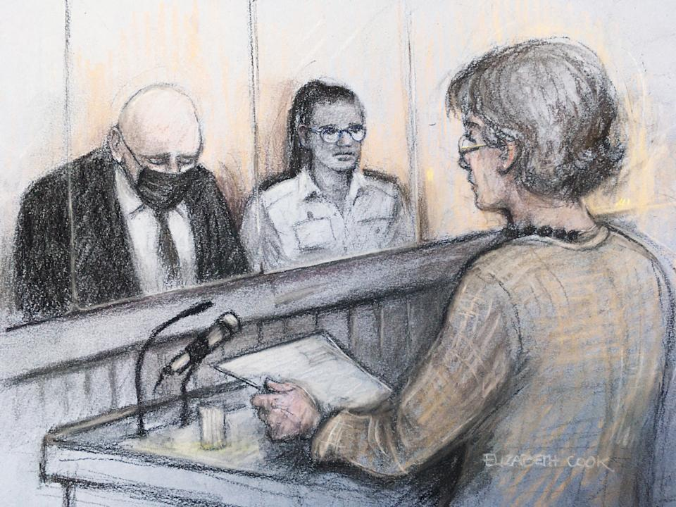 Court artist sketch by Elizabeth Cook of Susan Everard (right), the mother of Sarah Everard, reading a victim impact statement as former Metropolitan Police officer Wayne Couzens (left), 48, sits in the dock with his head bowed. (PA)