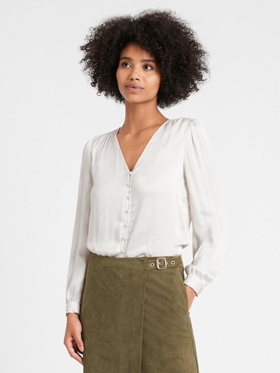 """<p>This <span>Banana Republic Soft Satin V-Neck Blouse</span> ($23) is perfect under a blazer. Can't you see <a href=""""https://www.popsugar.com/fashion/get-kamala-harris-suffragette-style-with-banana-republic-47956783"""" class=""""link rapid-noclick-resp"""" rel=""""nofollow noopener"""" target=""""_blank"""" data-ylk=""""slk:VP Harris wearing something like it"""">VP Harris wearing something like it</a>?</p>"""